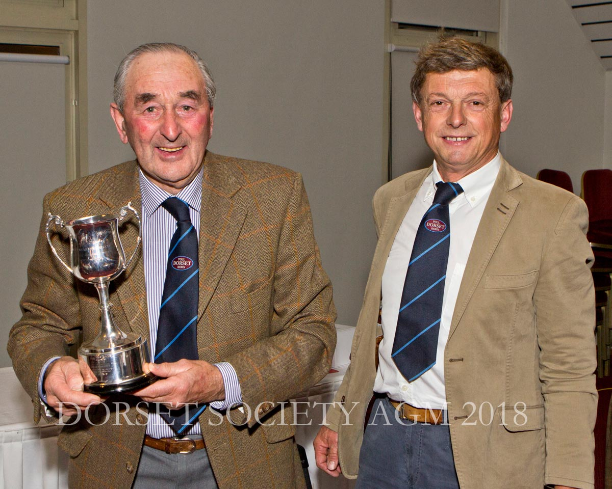 Francis Fooks presenting Phillip Baker with the Presidents Trophy for outstanding long service to the Society.
