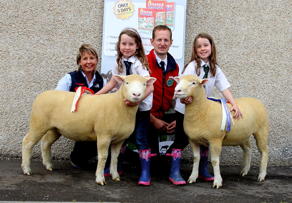 Reserve Champion Katie & Mollie Currie with Jacqueline Hamilton (Norbrook) and David Lewis (judge)