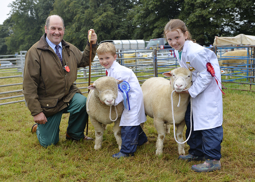 Young handlers judge, William Pate Mossilee Galashiels with Champion Young handler, Katie Royan (8) and Reserve Champion, Jack Royan (5).