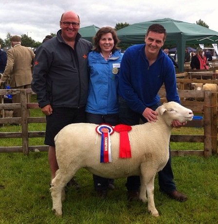Raymond Hill, owner of the Champion with Judge, Amy McConnell & handler Colin Jenkins