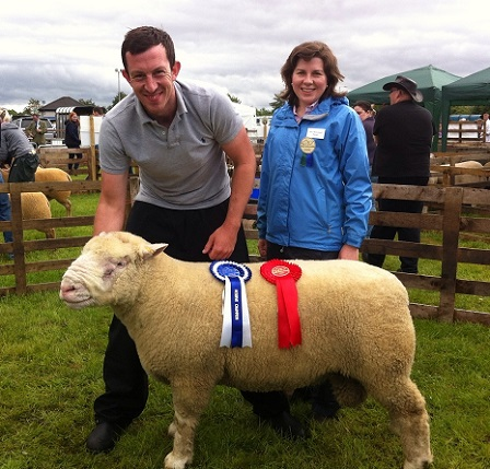 Ben Lamb with the Reserve Champion and Judge, Amy McConnell