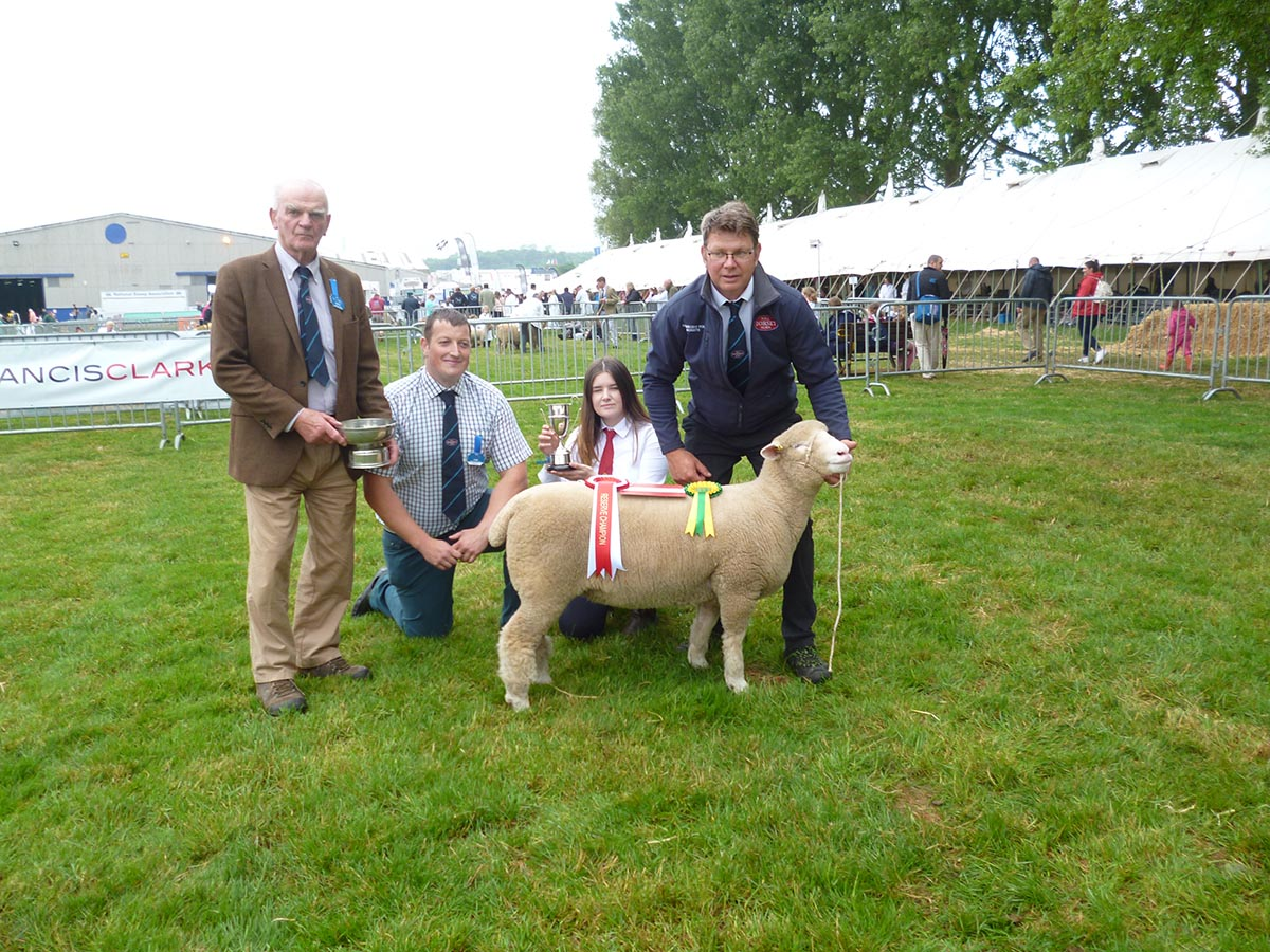 The Hole family receiving the Sherborne Flock Trophy for the breeder with the highest number of points, with from left Richard Hole, Adam Care, Judge, Sophie Hole and Rob Hole.