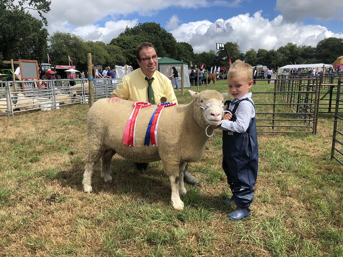 Gwynne Evans, Judge, left, with Tomi Hughes (Geraint Jones' grandson) and the Champion